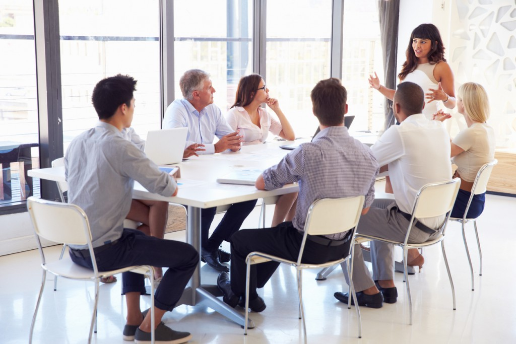 Group of businesspeople listening to a presentation